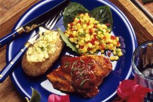 Barbecue chicken pairs well with corn or potatoes.