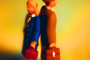 Businesspeople figurine standing back to back, side view