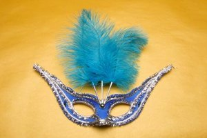 Spice up your Mardi Gras party by providing guests with decorative masks.