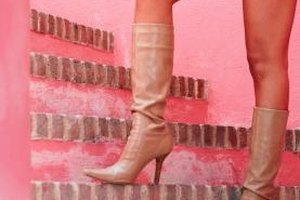 When you're wearing a miniskirt, boots with a stiletto heel can be a little too much.