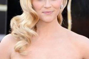 If you have a heart-shaped face like Reese Witherspoon, applying a satin finish blush to the apples of your cheeks helps draw attention to the center of your face.