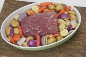 Pot roast often is cooked with potatoes, carrots and onions.