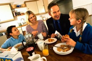 Join your kids at the breakfast table to encourage healthy eating habits.