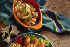 The acidity of shrimp ceviche and the bland richness of avocado complement each other well.