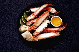 Crab legs cook quickly on the stove or in the oven.