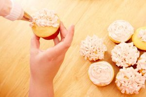 Cover your cupcakes with a layer of frosting before adding a fondant decoration.
