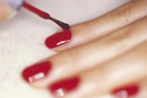 Start with a base of red polish and you can create fun candy cane-striped nails.