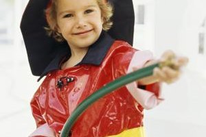 A red raincoat and a little reflective tape are the basic building blocks of a DIY firefighter's costume.
