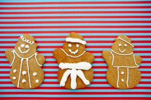 Use a round decorating tip to apply frosting to gingerbread men.