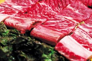Cooking beef ribs with moisture first ensures tender meat.