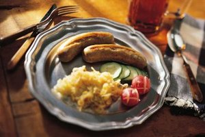 Traditional German cuisine includes poached and baked bratwurst.