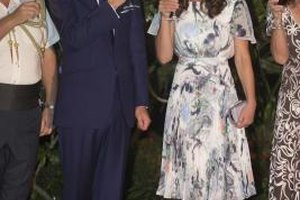 Kate Middleton wears a soft, flowing printed dress at an outdoor reception.