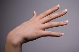 Soften acrylic nails before removing to prevent nail damage.