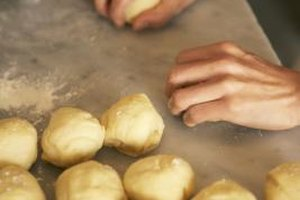Yeast rolls made with butter can be baked, cooled and frozen for later use.