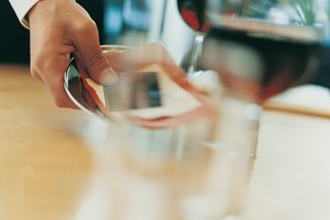 How Do Restaurants Process Tips on Credit Cards?