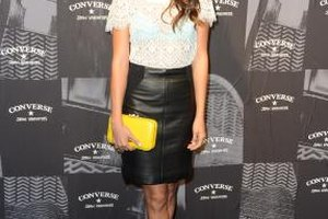 Actress Jamie Chung rocks gray suede booties with a black leather pencil skirt and feminine blouse during New York Fashion Week in 2012.
