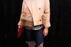 Blogger Kelly Framel sports over-the-knee boots backstage at Fashion Week.