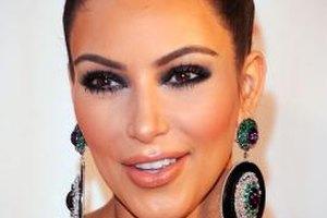Kim Kardashian looks fetching in a dark smoky eye and nude lip.