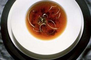 Oxtail soup may be served as a clear broth or loaded with meat and vegetables.
