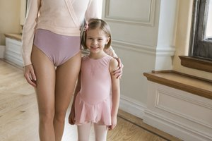 Portrait of mother and daughter dressed as ballerinas