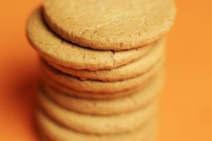 Cookies expand during baking by releasing steam.