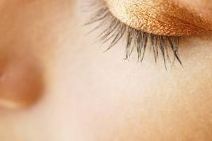 Eye makeup remover may take off some, but not all, of the glitter from your eyelids.