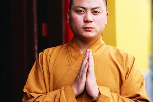How Does a Buddhist Show Complete Commitment to Their Beliefs?