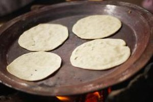 Tortillas cook quickly on the griddle.
