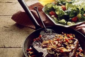 Add vegetables to the skillet to increase the flavor of pan-fried sirloin.