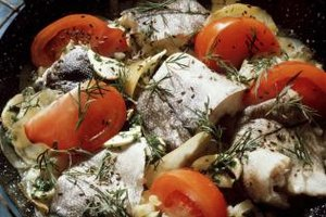 Pan-fry haddock with fresh vegetables and herbs to flavor the fish while it cooks.