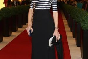 Eva Riccobono wears a sophisticated black skirt with her striped sweater at a Vogue fashion event in Dubai.