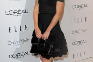 Katie Holmes pairs her lace ruffle skirt with a simple black top and pumps for a sophisitcated evening look.