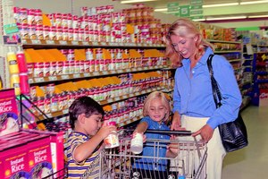 Mom and kids shopping in grocery store