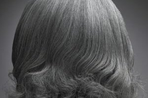 Smooth umanageable gray hair with the right styling products.