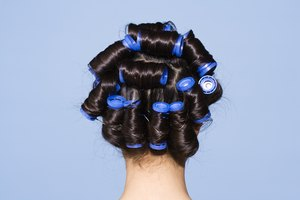 How to Roll Hair Into Curls Using Hot Rollers