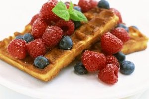 Substitute fresh berries for syrup for a healthier morning waffle.