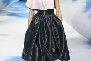 A model shows off a Dior cape during a fashion show in Moscow in July 2013.