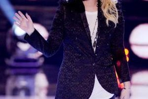 Demi Lovato pairs a textured velvet blazer with black leather pants for an edgy look.