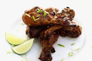 Marinating chicken legs and thighs infuses them with added flavor.