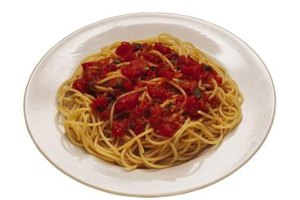 Serving your spaghetti with a simple tomato sauce creates a lower calorie meal.