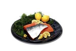 Place ingredients such as sliced lemon and fresh herbs in the packet to elevate the flavor of salmon.