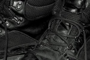 Black combat boots come in a variety of fabric, but are most commonly made of leather or faux-leather.