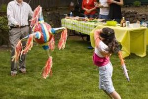 Make it a sweet and festive event with a candy-filled piñata.