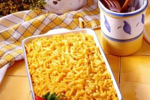 A large pan of macaroni and cheese can bring guests to the table.