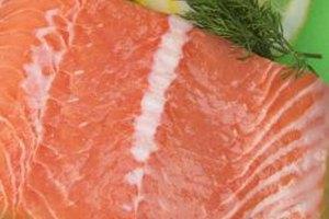 Season salmon prior to steaming.
