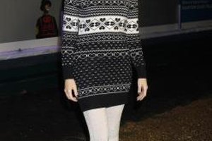 Linzi Stoppard pairs her black Uggs with a Fair Isle sweater and fur hat for an alpine look.