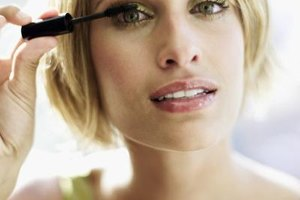 Comb the brush through lashes from roots to tips.