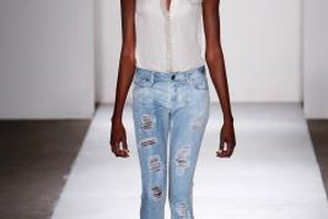 A model wears distressed denim in a DL 1961 Runway show.