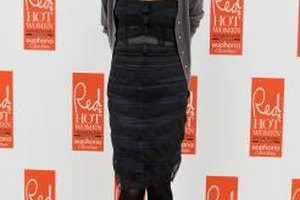 English actress Sadie Frost layers a cardigan over her strapless dress and adds tights to make it winter-ready.