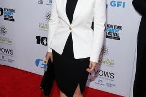 Actress America Ferrera wears a bright white blazer over her black cocktail dress.